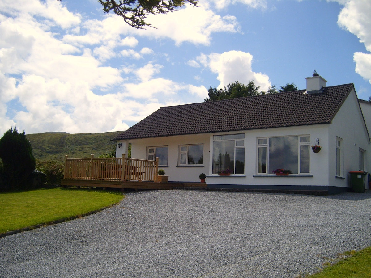 Decking to the front with views over Tralee Bay