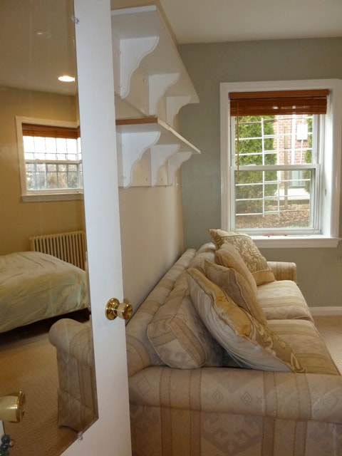 Two windows allow for lots of nice light.  A couch provides a sleeping space for an additional guest, or a place to curl up and read.