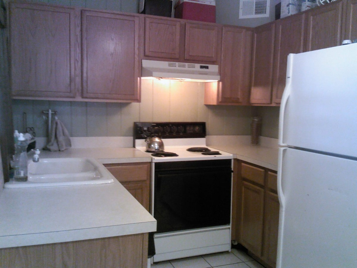 Kitchen, complete with dishwasher, full selection of cookware, serving ware, and utensils.