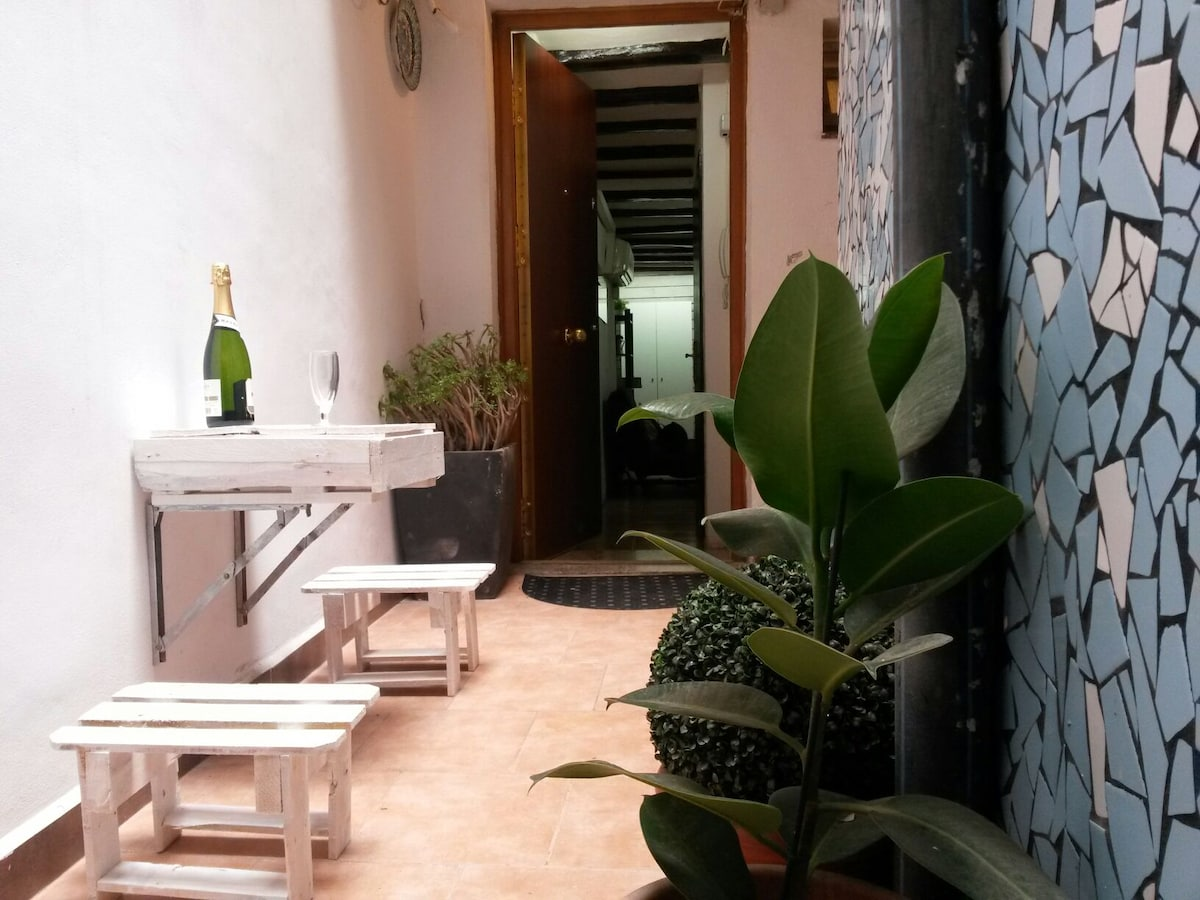 Right outside of the apartment, in the common areas of the building, you can sit and relax having a glass