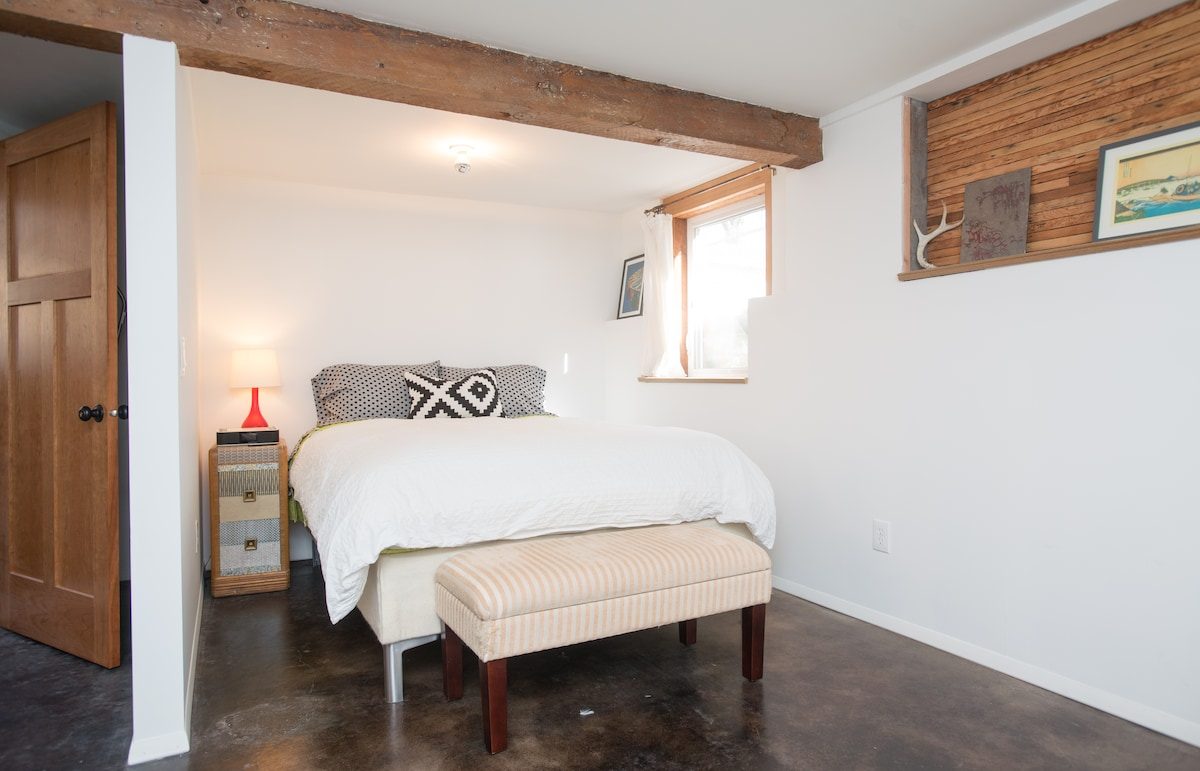 Queen size bed + rough sawn beams make for sweet dreams.