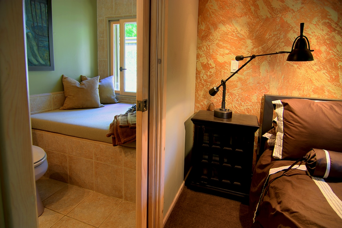 The master bedroom and adjoining bath.