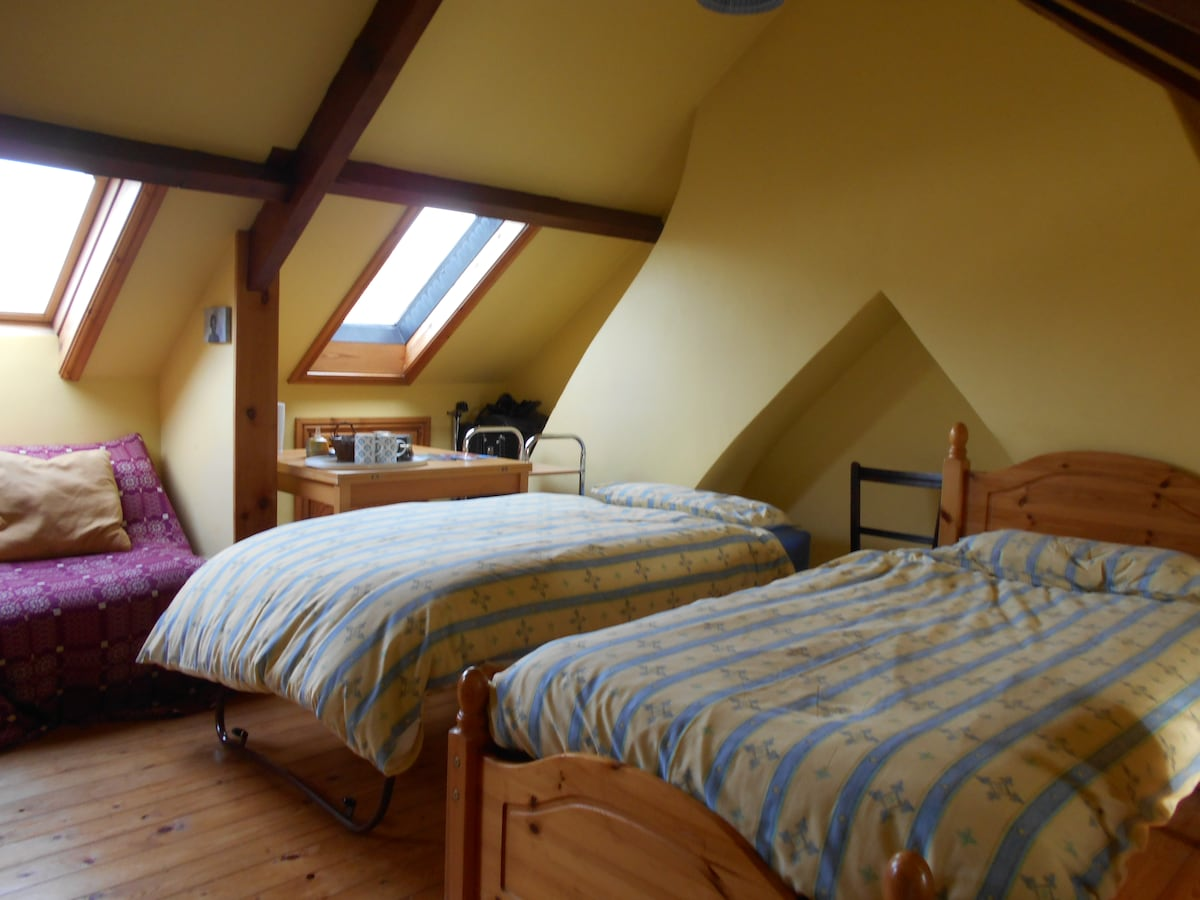 Another view of the bedroom in the loft