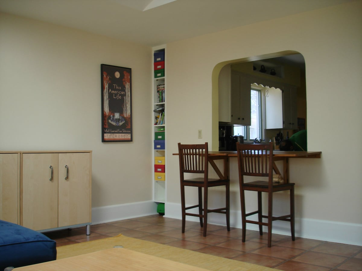 The family room connects to the well-equipped kitchen.