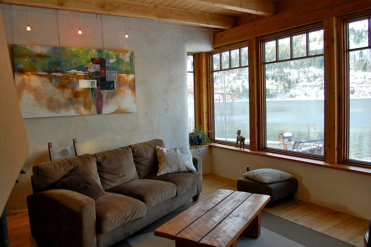 Living room in Eco-Home and view of Kootenay Lake.