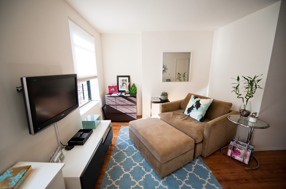 Living room is perfect for two in the Crate and Barrel Chair and a Half with Ottoman