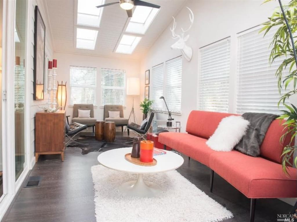 Sunroom with (not pictured) new West Elm Queen Sleeper Sofa and Sleeper Futon