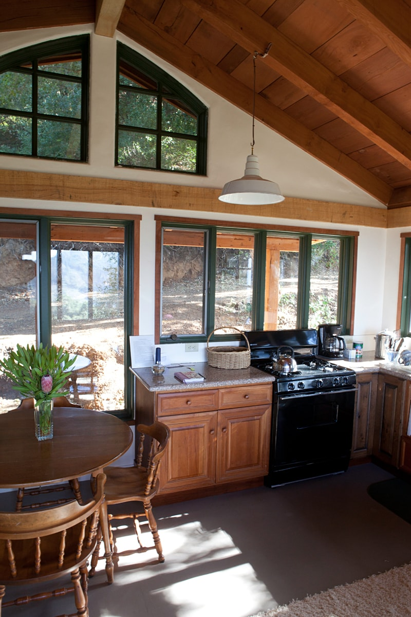 Kitchen area showcasing redwood beams and oak collar bean throughout cottages