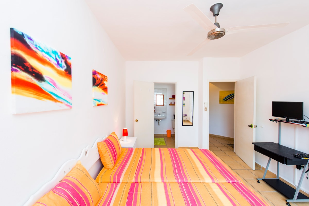 Colorful bedroom close to the beach