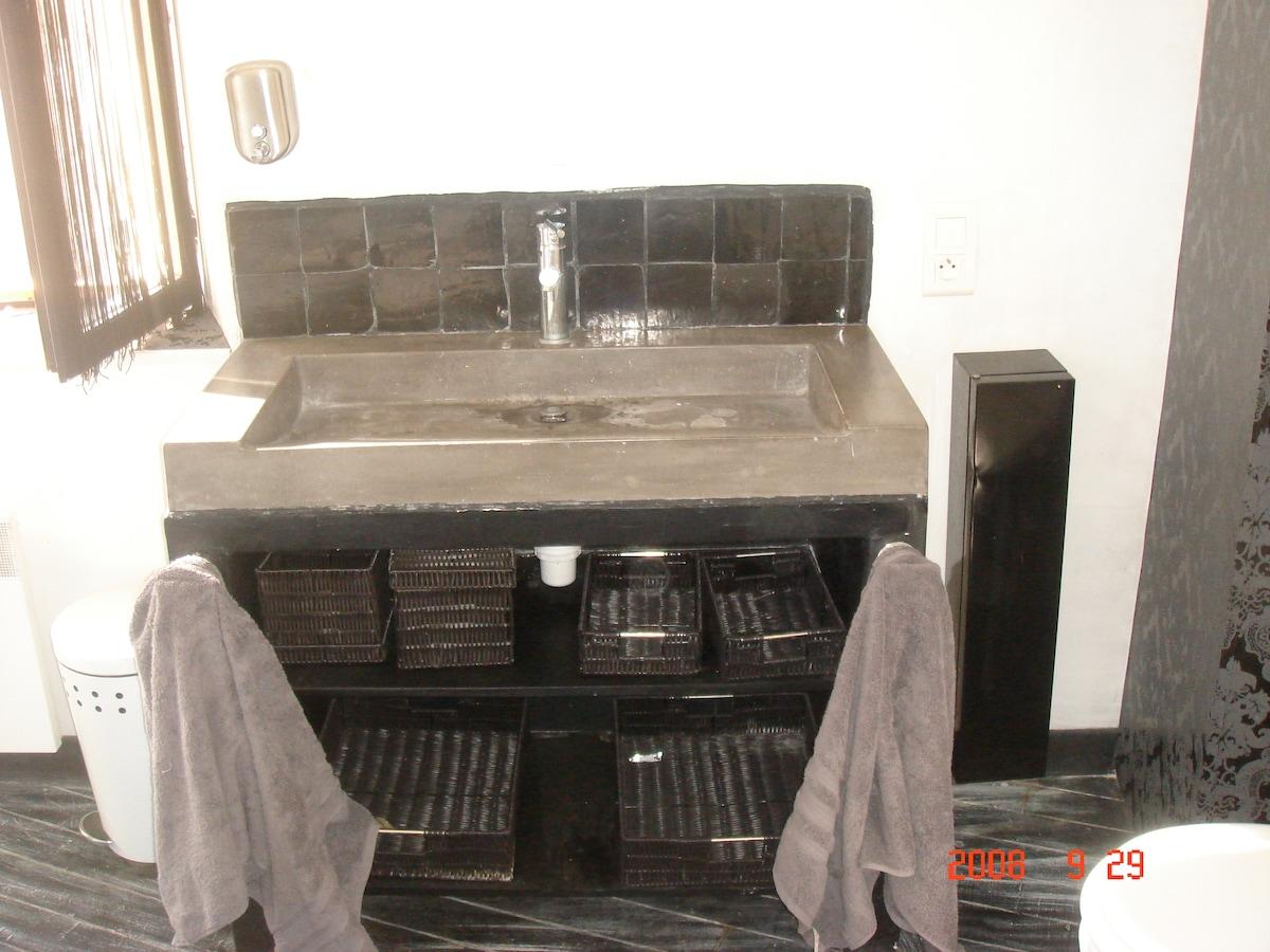 Concrete bathroom sink.