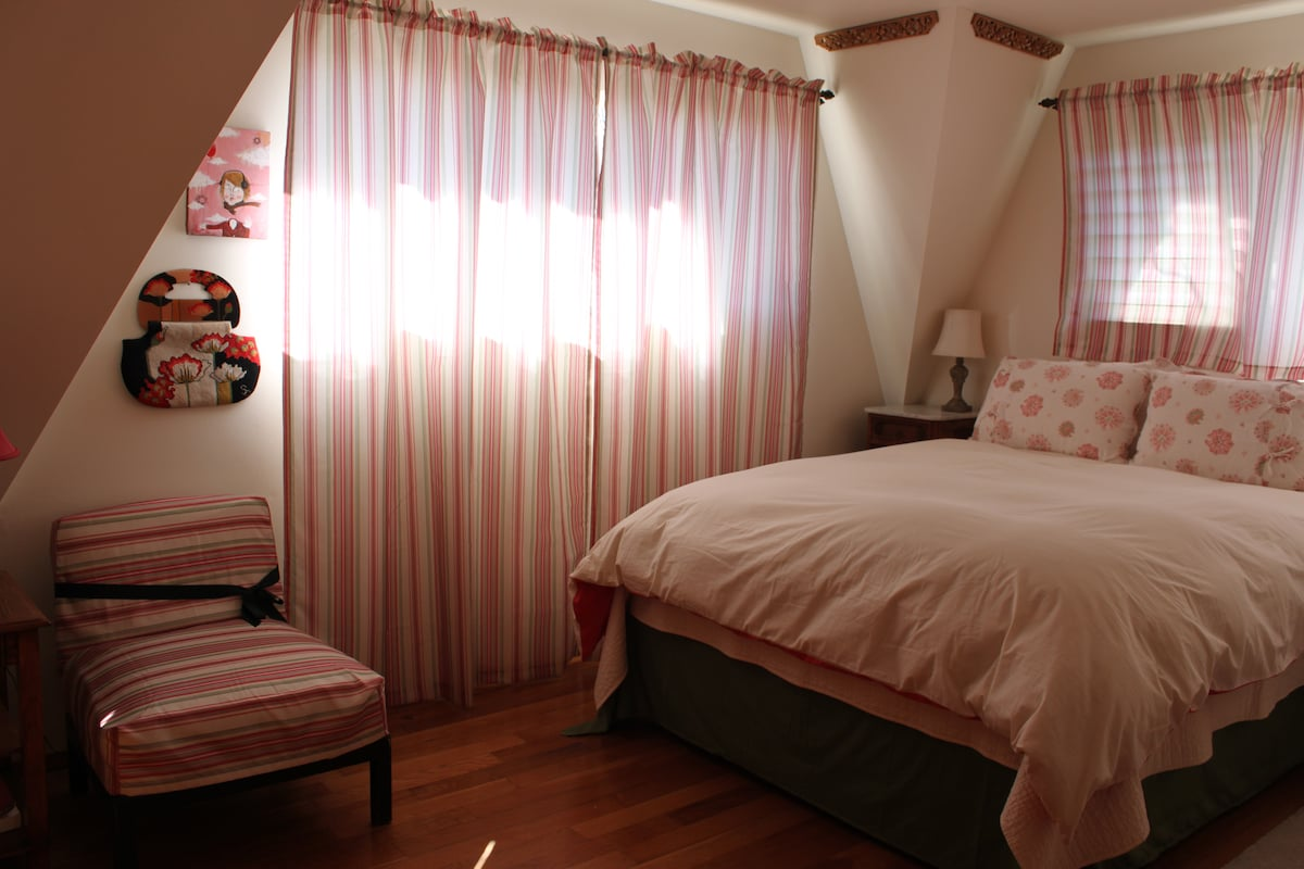 The largest bedroom with queen bed.