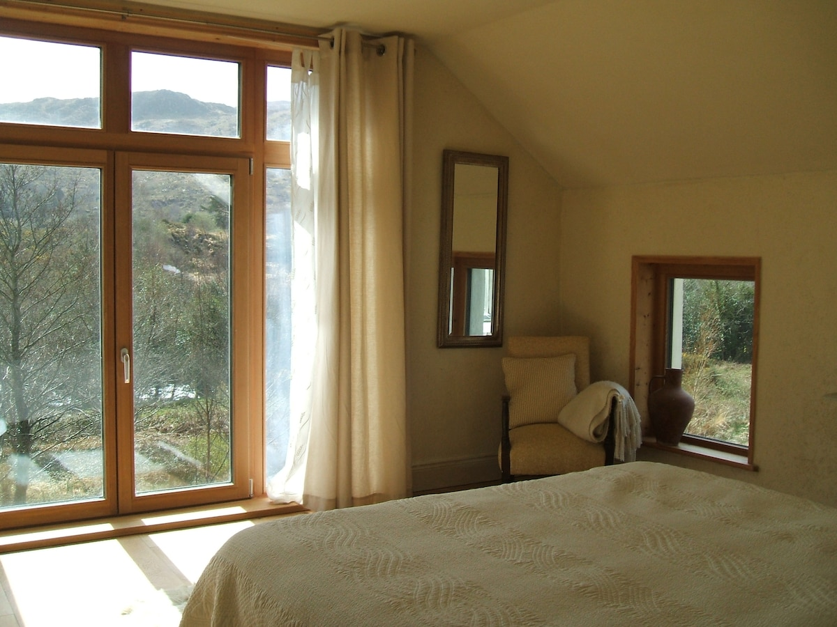 main bedroom river, hills, south....