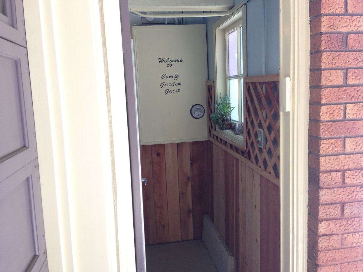 door opens into a walkway that leads to your room