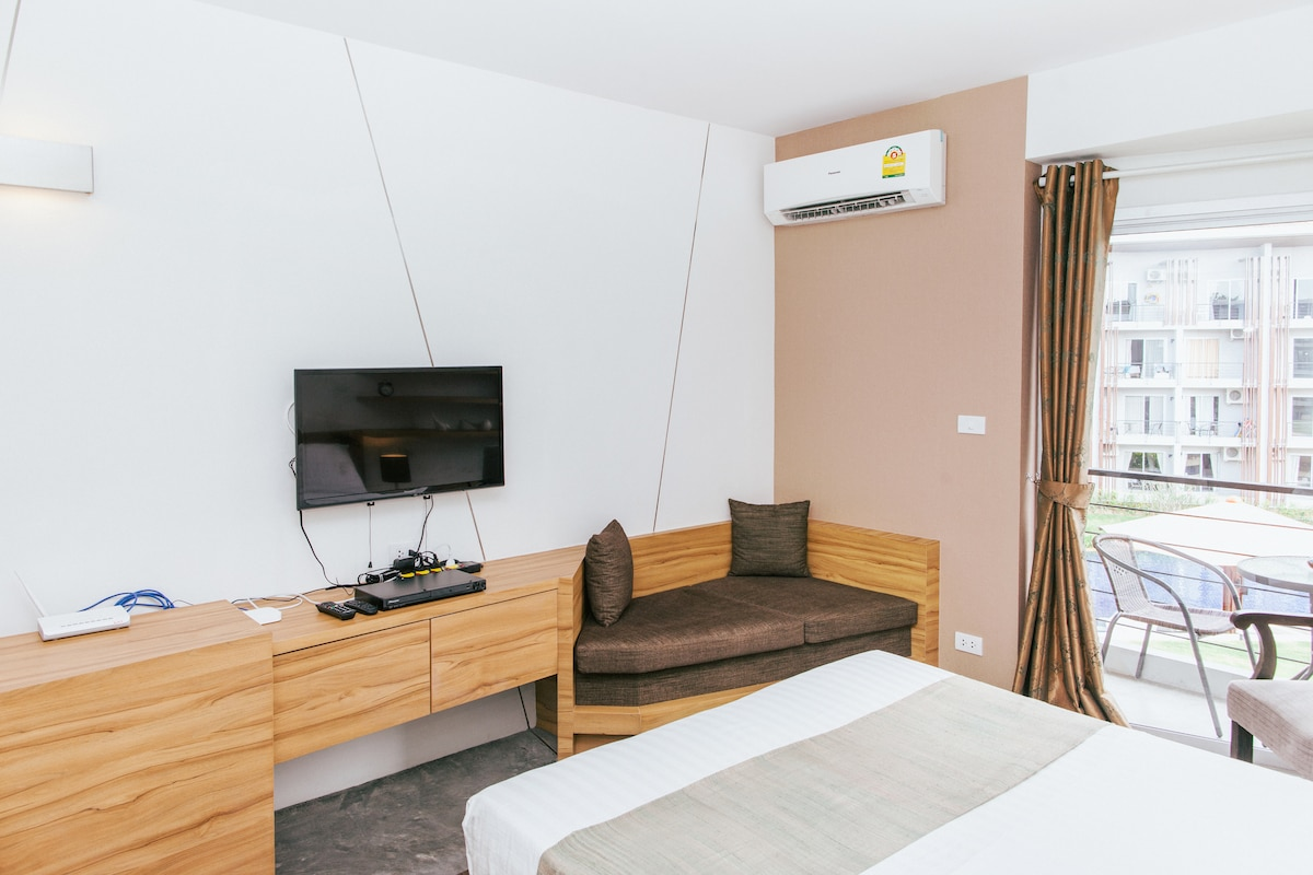 Aircon, flat screen TV with International channels & DVD player.