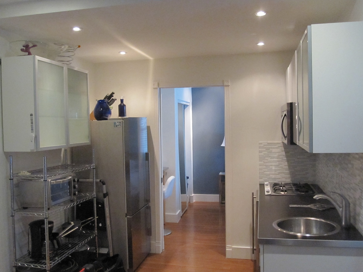 Full kitchen with wine cooler and Gaggeneau gas stove