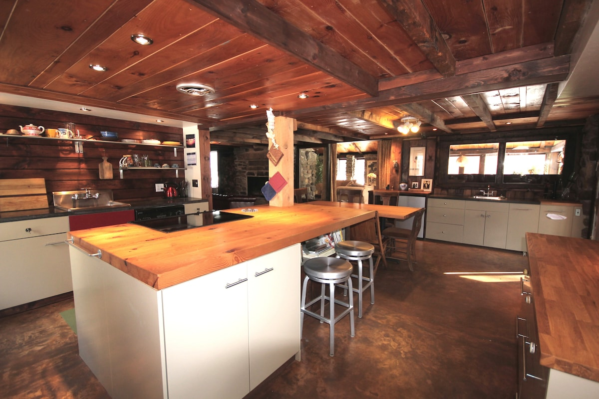 A true cook's kitchen with everything an iron chef. Radiant heat  floor, handmade countertops, two sinks. Screened-in porch off the kitchen.