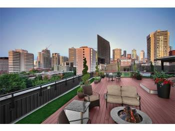 Beautiful City View from the Rooftop Deck complete with seating and FirePit!
