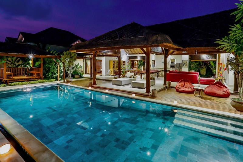 Exterior and swimming pool at night