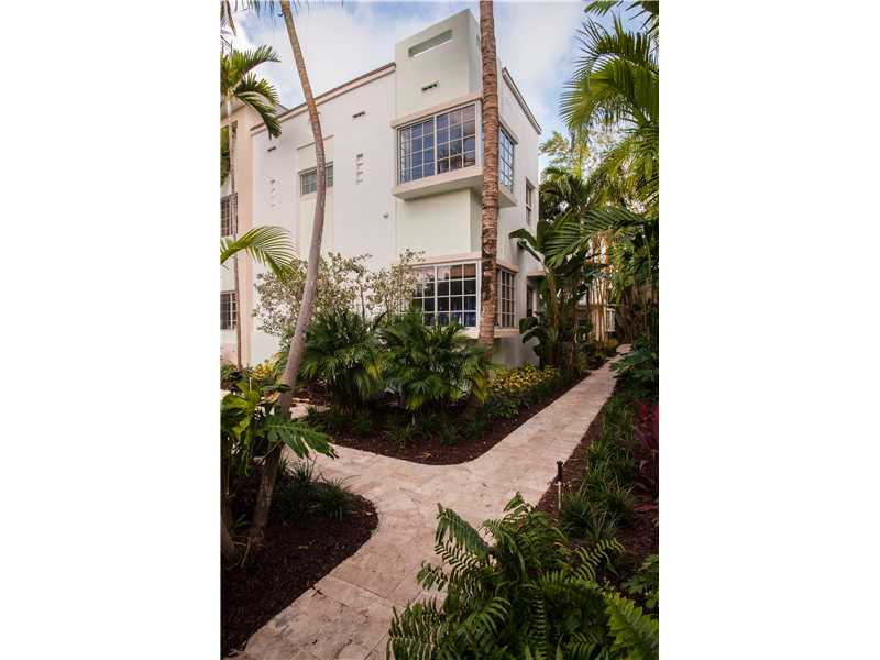 Building entrance. Enjoy a drink in the patio in this enchanting tropical garden
