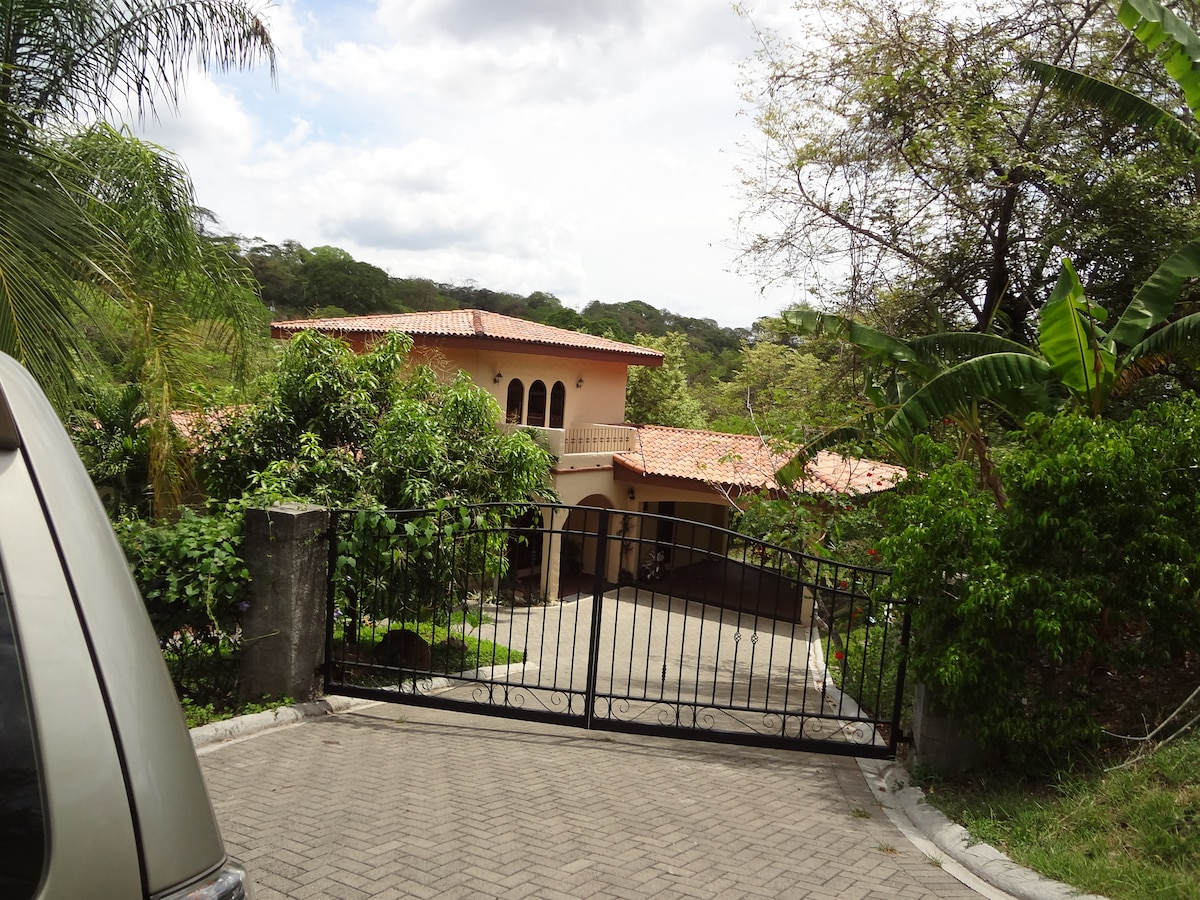 Private gated drive to the three bedroom home.