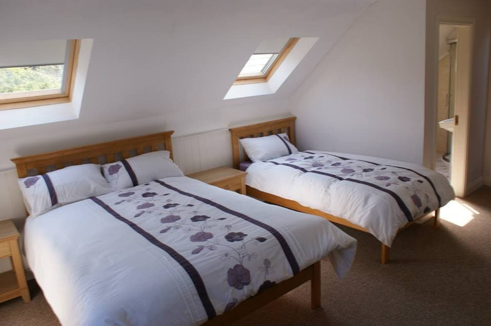 En suite master bedroom with double and single bed