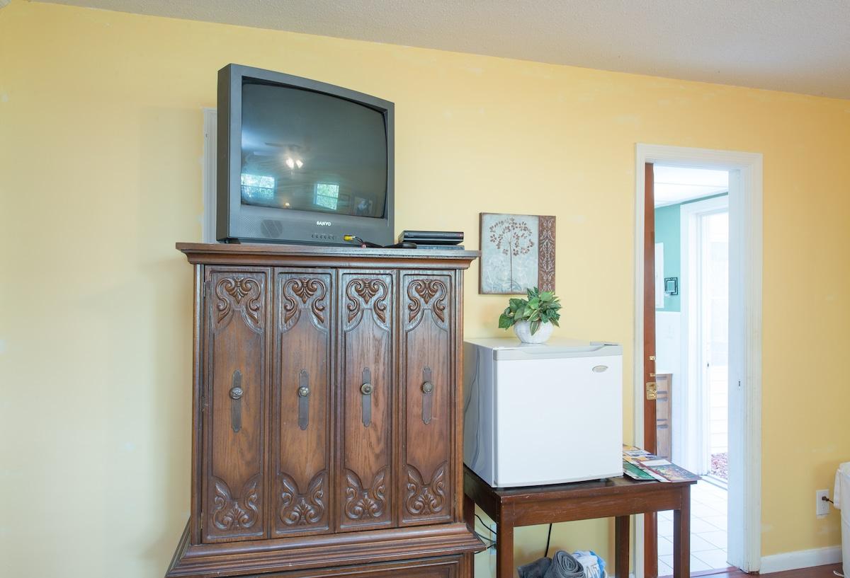Mini fridge in the bedroom.