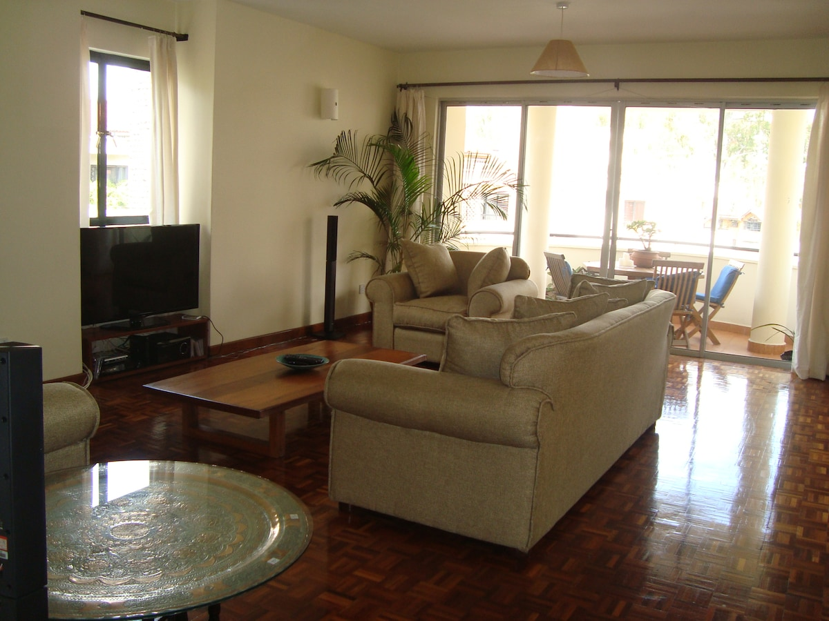 Big living room with huge TV, cable, wifi and entertainment centre