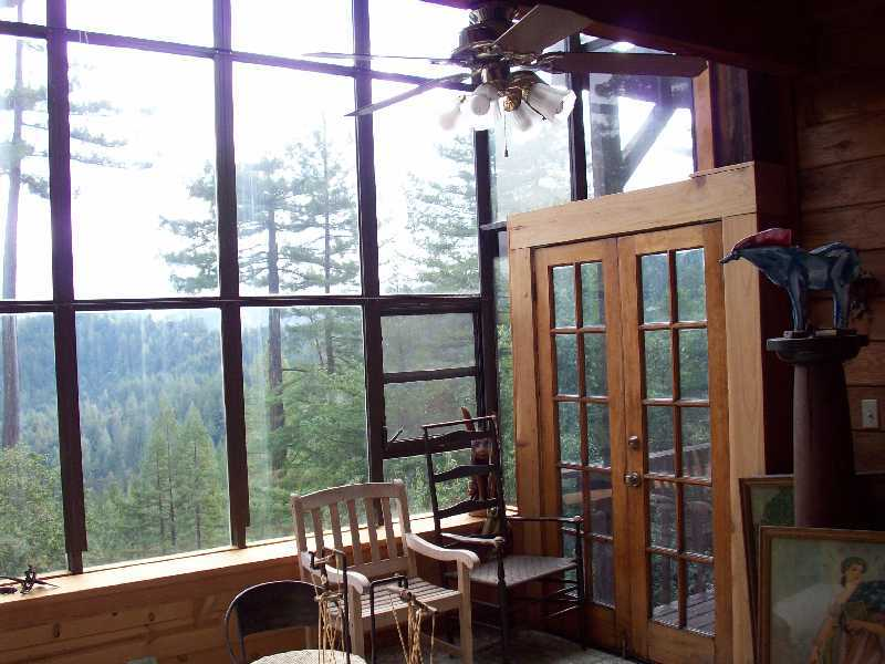 Part of the huge solarium with view to redwoods and Russian River.