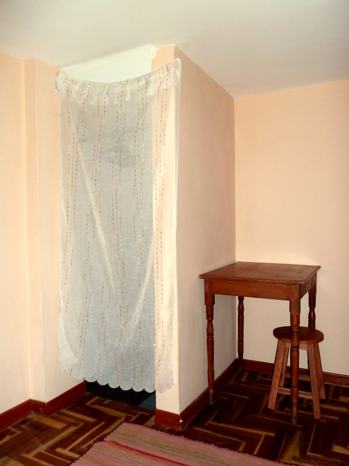 Cupboard with hanging space, table & stool