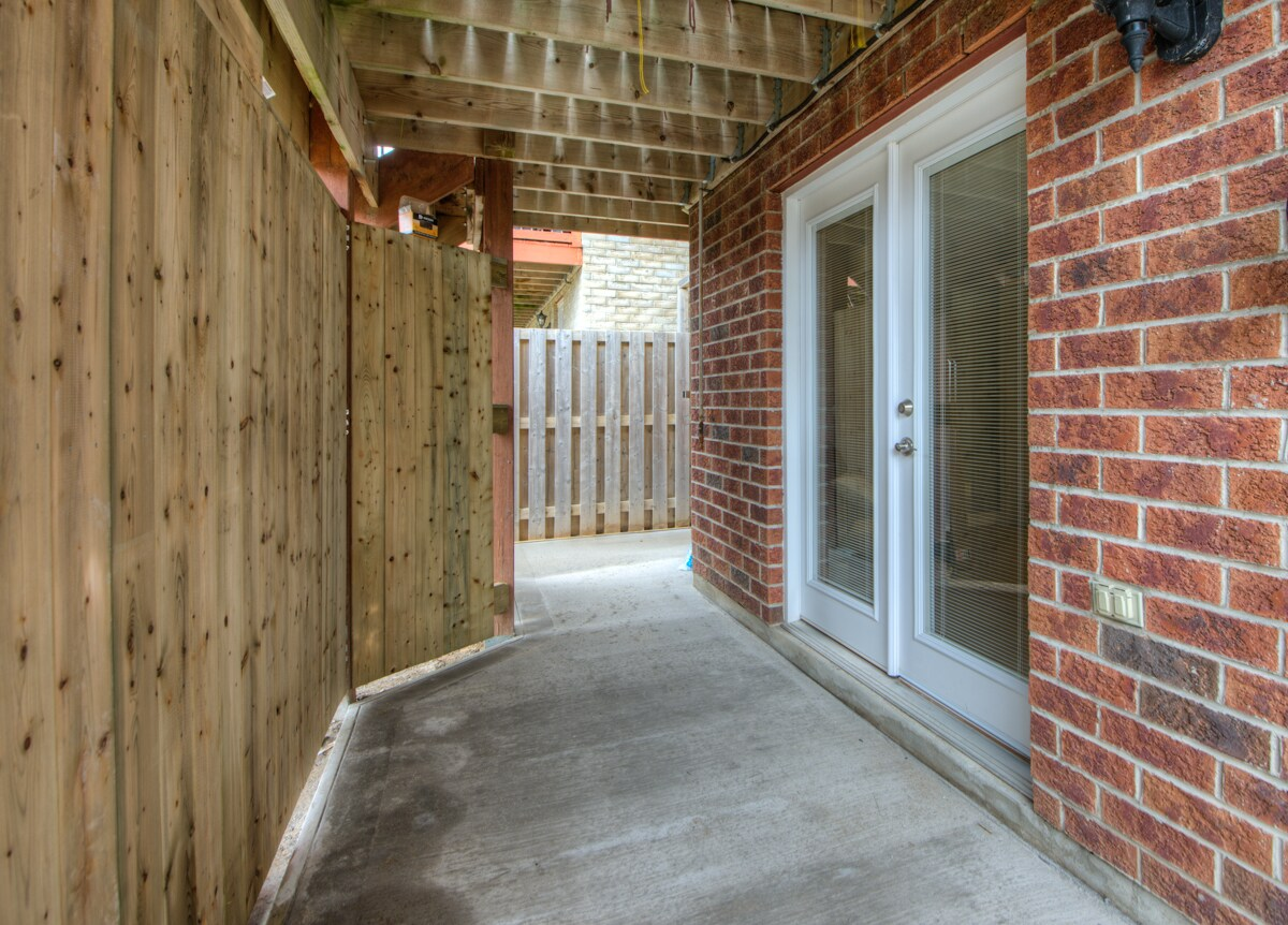 """Double garden entry doors invite you into your """"home away from home""""."""