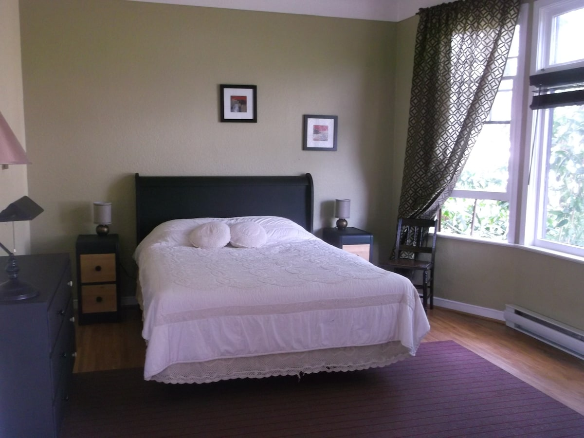 Downstairs front bedroom with french doors