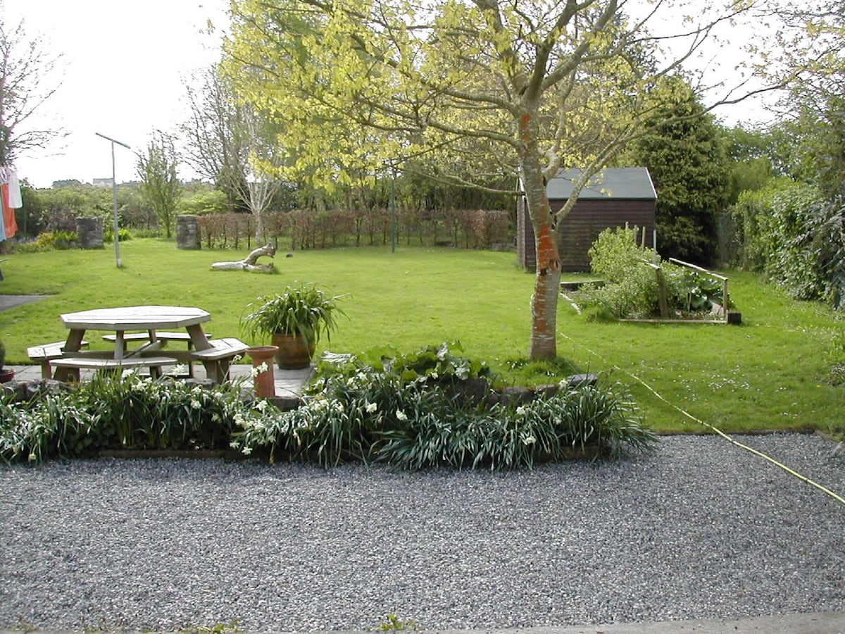 This is our rear garden and yard, with a small picnic area in the foreground.
