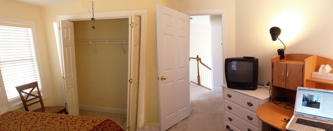View from the Guest Room of the bed, closet and hall.