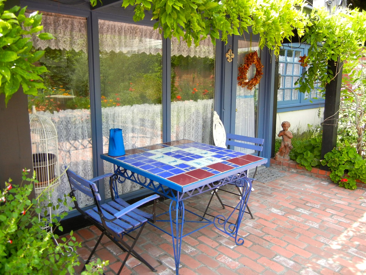 Enjoy outdoor dining at your leisure. Wine and cheese, anyone?