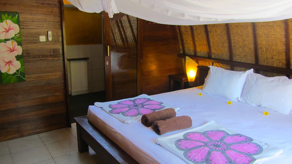 this is your room - very bright with a super kingsize bed, lovely deco, wardrobe and aircon,tiled floor,all natural materials
