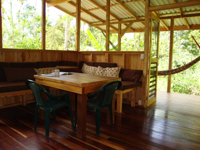 The main room, looking out through the screen doors onto the open deck.