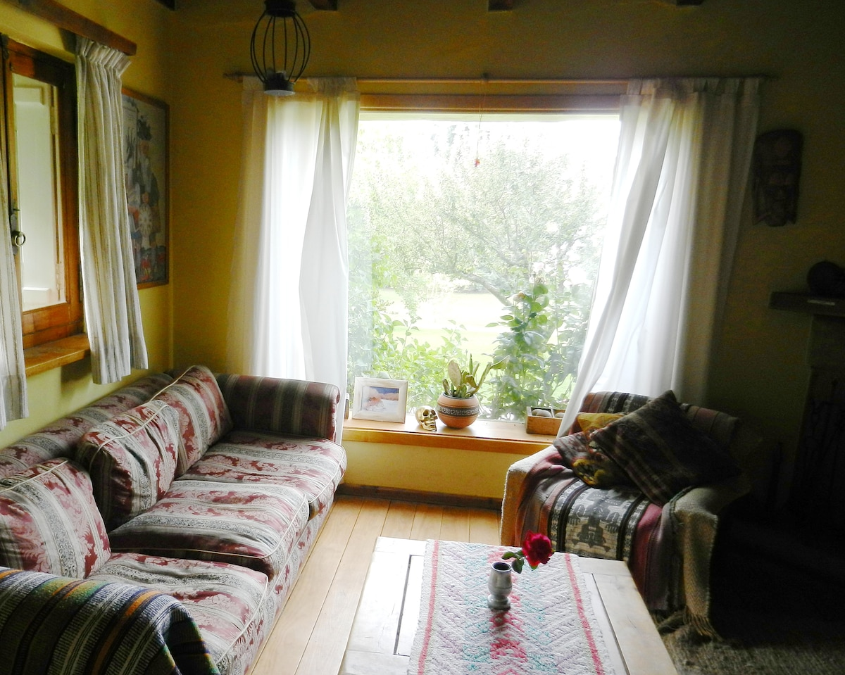 Livingroom, picture window with garden and lake view