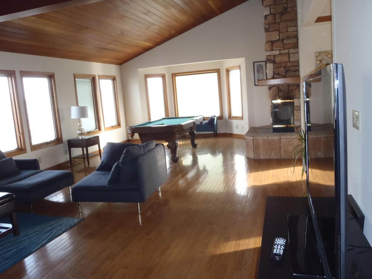 Spacious open concept Great Room with wood ceilings