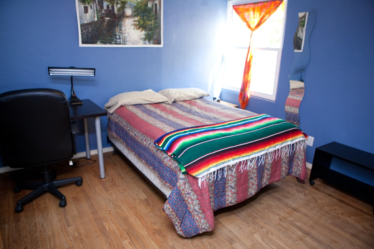 Great Bedroom with Queen Size bed and two kids desks.