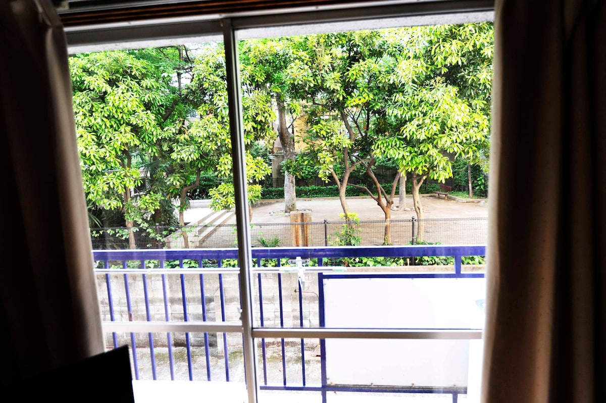 Nice balcony view of green park outside of bedrooms