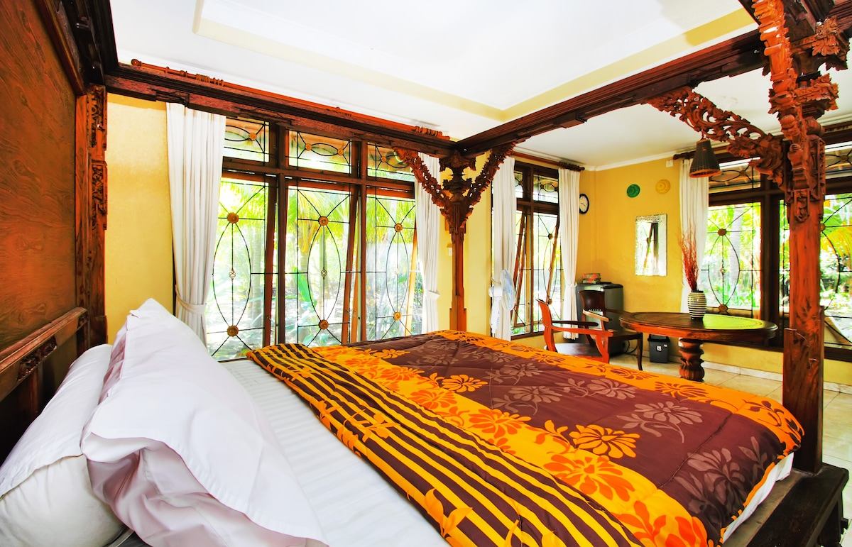 View from the king size bed with multiple garden views