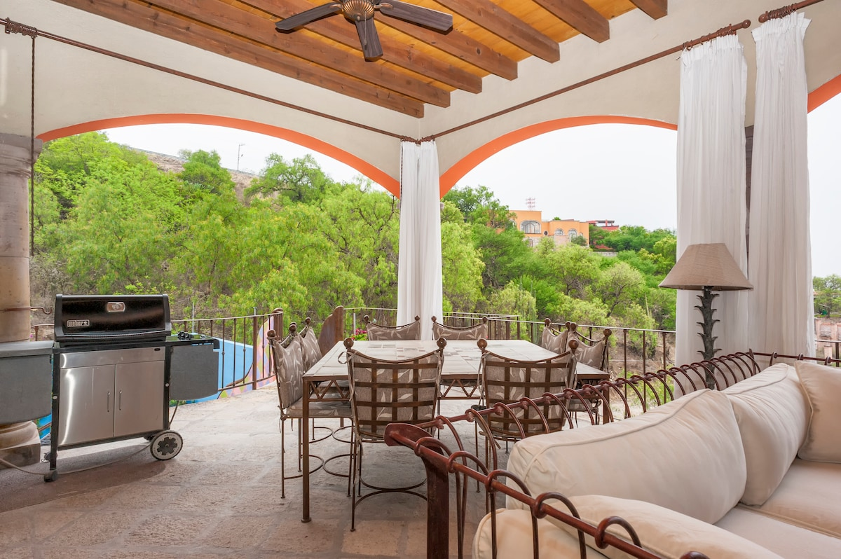 Dining area and gas grill, plus a peek at the slide to the pool