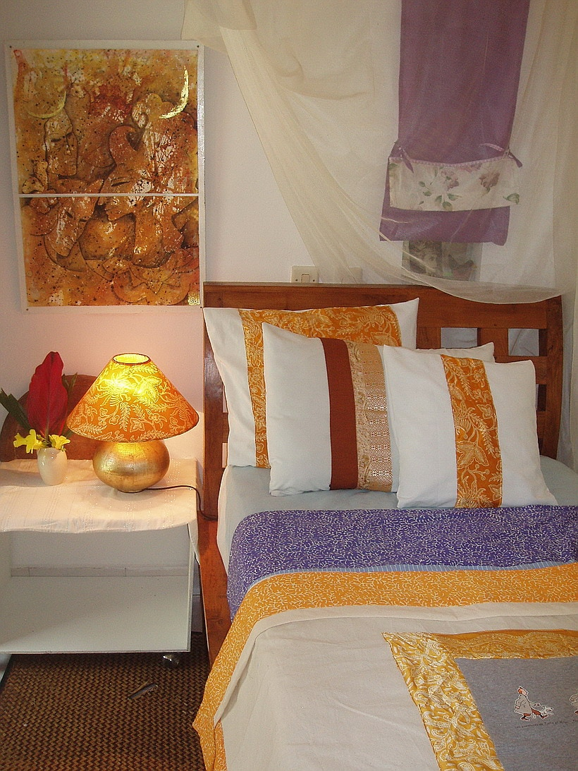 bedlinen  in Solar Yellow silk and cotton. Owner's painting on wall, watercolor and gold leaf.