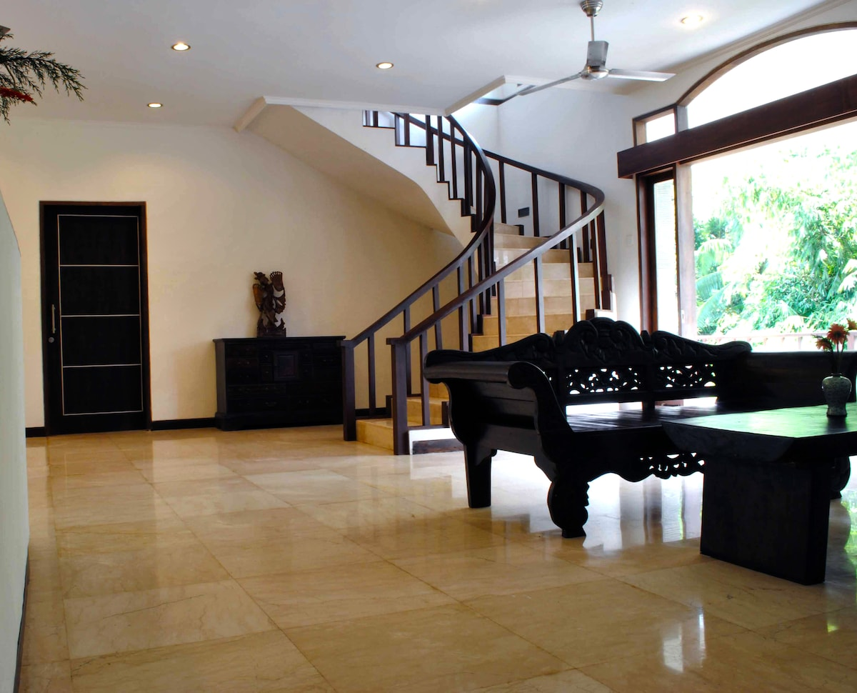 The main entrance directly into living room area