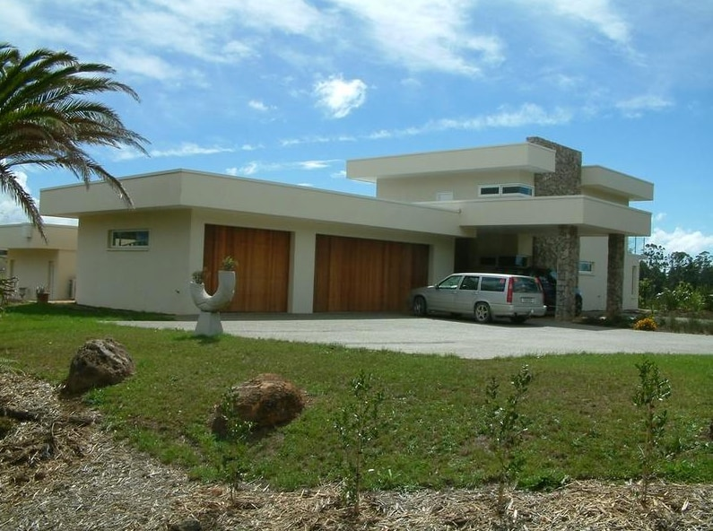 View from the entrance shows rear of the house with ample parking.