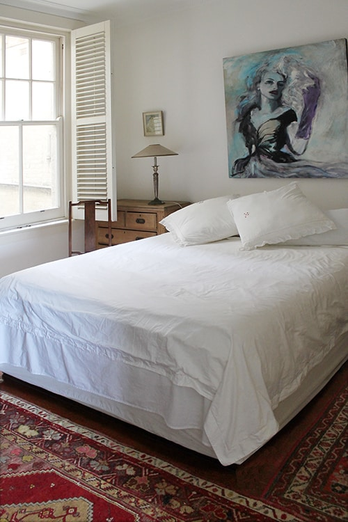 Very comfy queen size bed with white fresh linen.