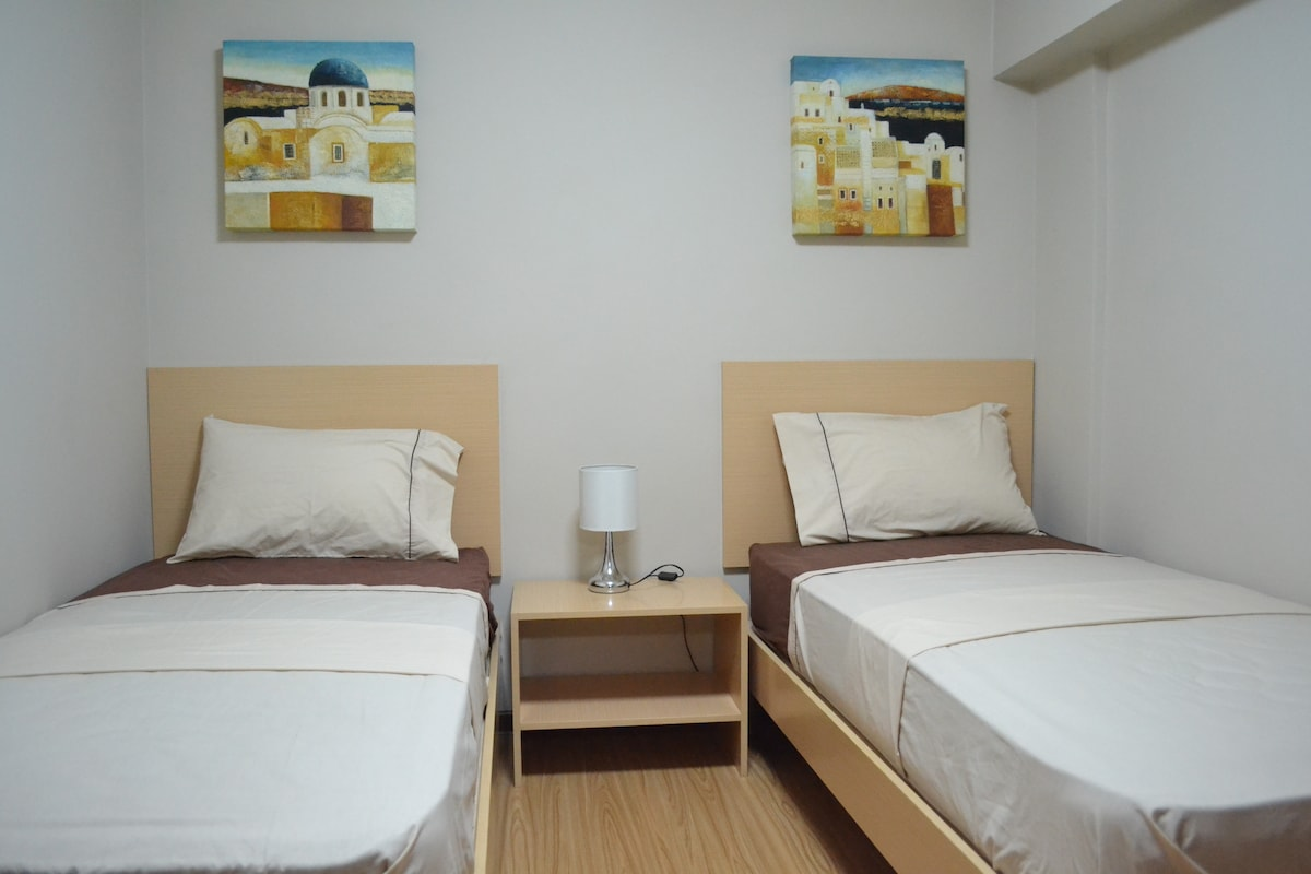 Two single beds in the second bedroom