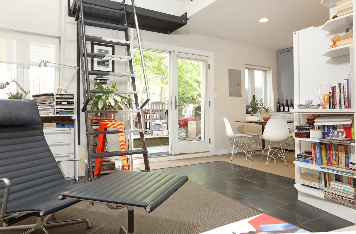French doors into Kitchen and Living Room stairs to loft