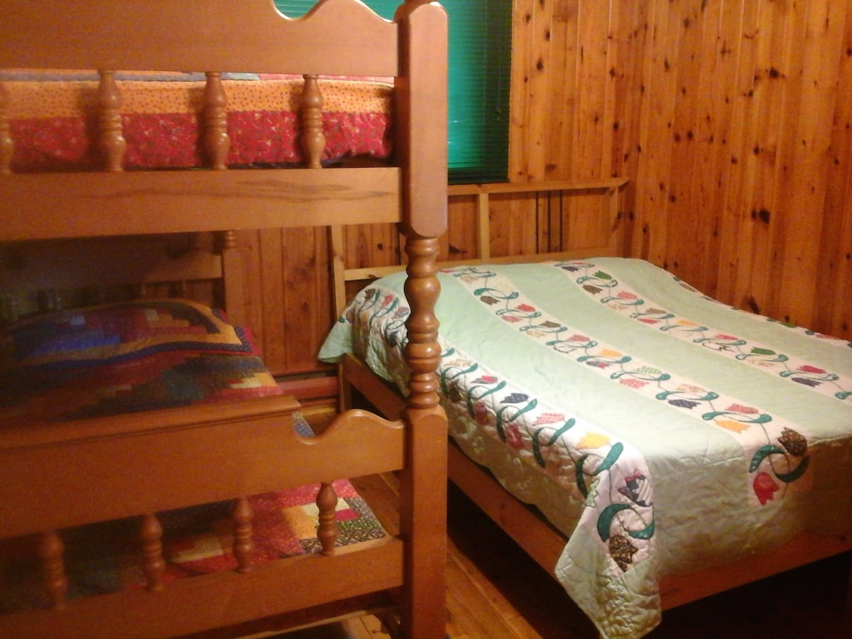 Single-over-single bunk bed, shares room with double bed.