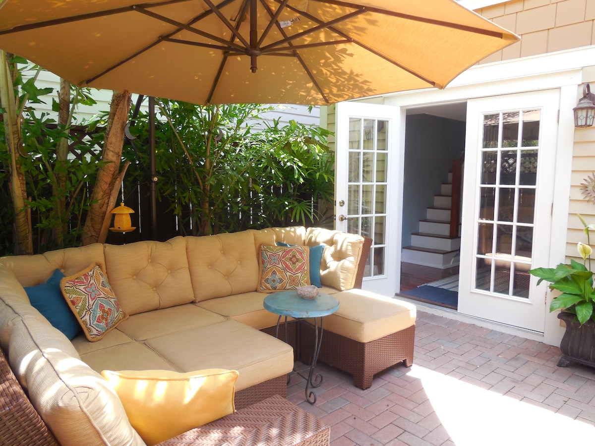 The shared courtyard and outdoor space in front of the french-door entry to the cottage.